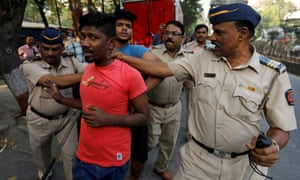 Members of the Dalit community are detained by police during a protest in Mumbai.