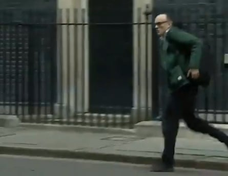 Dominic Cummings running out of Downing Street shortly after Johnson announces he has tested positive for coronavirus.