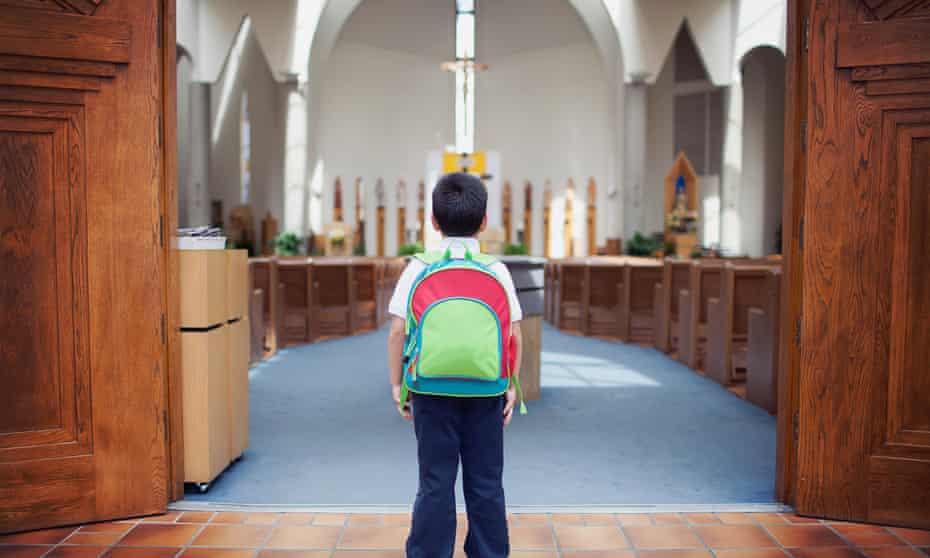 School boy at door of church