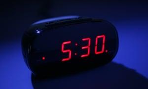 An alarm clock in dark saying 5.30