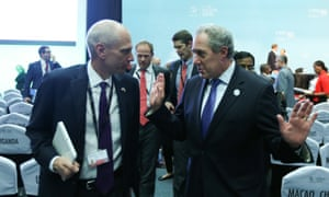 US trade representative Michael Froman speaks to a delegate at the tenth ministerial conference of the World Trade Organisation in Nairobi.