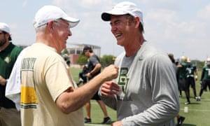 Baylor University's former president Ken Starr, left, jokes with former head football coach Art Briles in 2014.