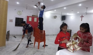 Children are busy cleaning and decorating a church for the Christmas in a small Christian locality in Aligarh.
