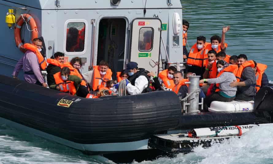 A group of people thought to be migrants are brought in to Dover onboard a Border Force patrol vessel