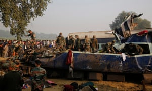 Indian Army personnel take part in the search for victims after the Indore-Patna Express train derailed near Pukhrayan.