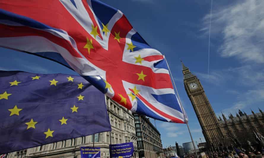 UK and EU flag outside parliament