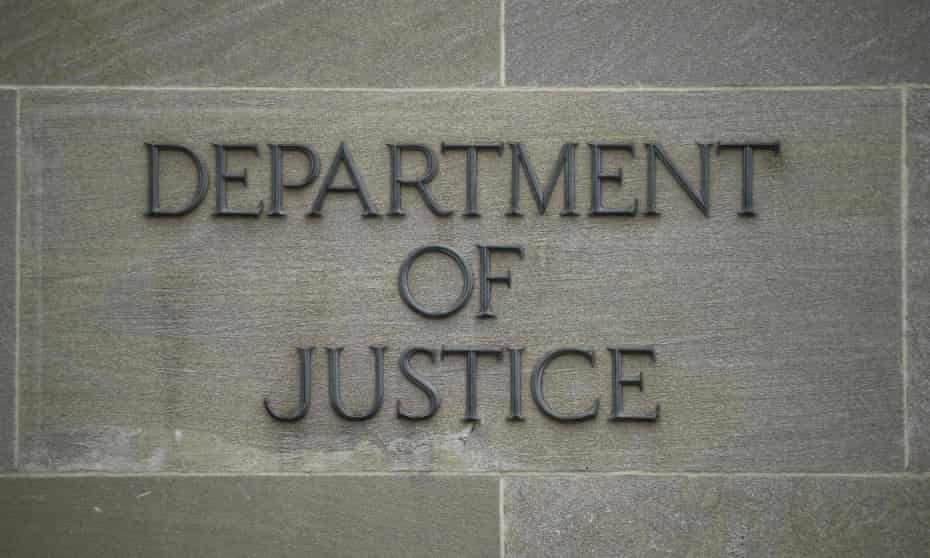 """A """"Department of Justice"""" sign on the wall of the US Department of Justice building in Washington, DC."""