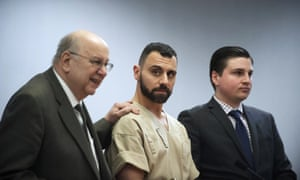 Richard Dabate, center, appears with attorneys. Dabate became a suspect in his wife's murder after the data found on her Fitbit contradicted his timeline of events.