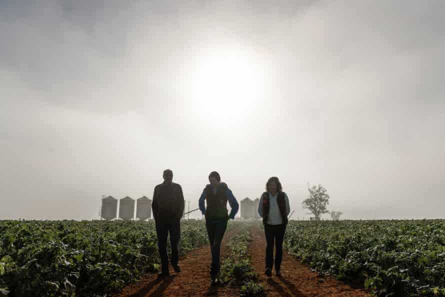 Emily, Lisa and Ambrose Doolan walk on their property.