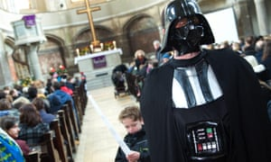 A churchgoer attends the service dressed as Darth Vader.
