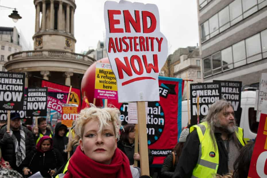 Demonstrators calling for an end to the cuts