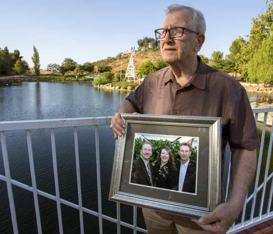 Frank Kerrigan holds a photograph of his three children – John, Carole and Frank.