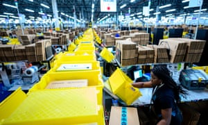 Aa woman works at a packing station at an Amazon fulfillment center in Staten Island, New York. A similar facility in Bessemer, Alabama, could be the first to unionize depending on a vote scheduled for 8 February.