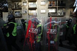 Protesters confront the police near Plaza de las Tres Culturas to commemorate the 52nd anniversary of a student massacre in Tlatel