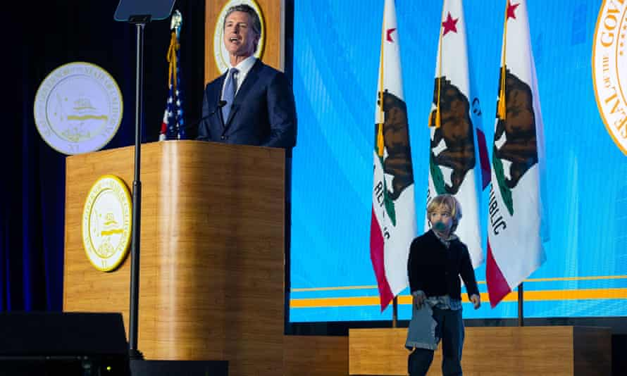 Joint ticket: Gavin Newsom sworn in a Governor of California as his son invades the stage