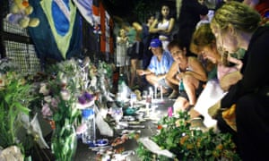 Relatives and friends of victims light candles after the blaze at the Buenos Aires music venue.