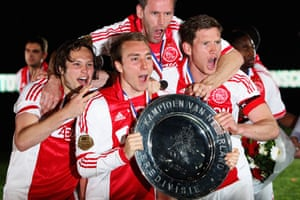 Daley Blind, Christian Eriksen, Andre Ooijer and Jan Vertonghen celebrate after winning the Eredivisie title in 2012.
