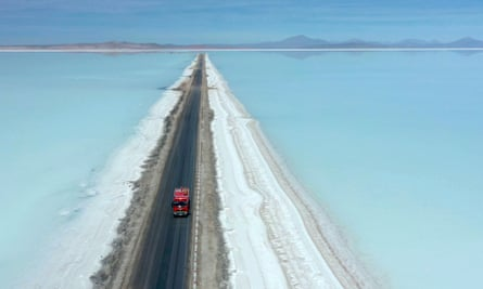 Aerial view of a truck on a road crossing the flooded southern zone of the Uyuni Salt Flat, Bolivia, July  2019.