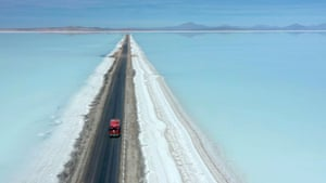 A truck crossing the flooded southern zone of the Uyuni Salt Flat, Bolivia.