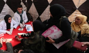 Egyptian doctors offer medical advice to women and girls about FGM as part of an awareness campaign.