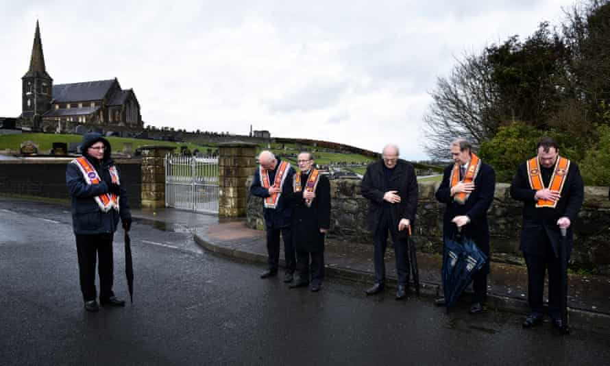 Members of the Orange Order hold a prayer service during their weekly protest at Drumcree Church on February 26, 2017