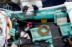 Longline fishing vessels caught illegally transferring fish at sea.