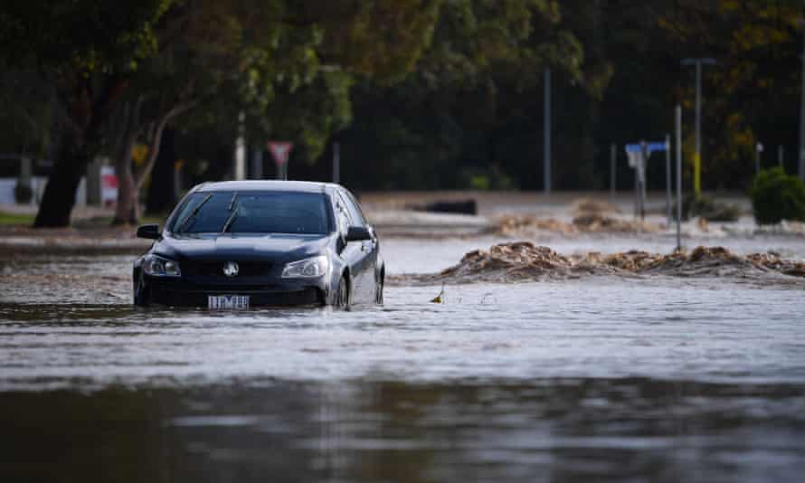 A car is seen submerged in flood water in Traralgon, Victoria