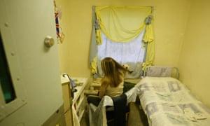 A female prisoner brushing her hair