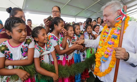 Mexico's president, Andrés Manuel López Obrador, shakes hands with children while visiting towns in the south-western state of Guerrero.
