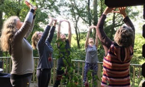 women doing stretches outdoors at Yoga and Spice