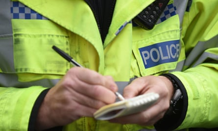 Police officer writes in notebook