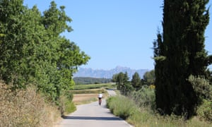 Harriet cycling towards mountains of Montserrat.