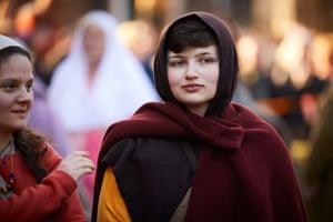 Women in costume prepare to take part