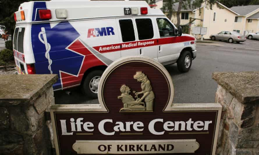 An ambulance transports a person from the Life Care Center of Kirkland, a long-term care facility linked to several confirmed coronavirus cases, in Kirkland, Washington state on Tuesday.
