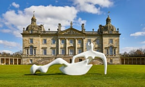 Henry Moore's Large Reclining Figure on the lawn in front of the grand  Houghton Hall, Norfolk.