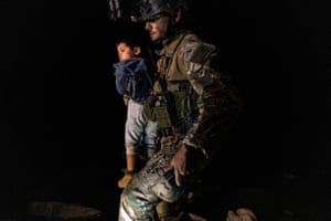 Roma, Texas, USAn asylum-seeking migrant boy is carried by a department of public safety agent after crossing the Rio Grande river into the US from Mexico
