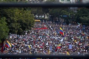 Thousands of people protest against president Nicolás Maduro as Juan Guaidó, the president of the Venezuelan parliament, announces that he has assumed executive powers, in Caracas, Venezuela.
