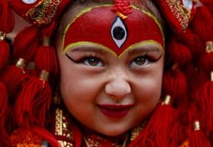 Kathmandu, NepalA young girl dressed as the living goddess Kumari participates in the Kumari Puja festival