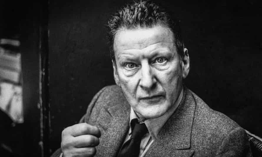 Black and white portrait of Lucian Freud staring intently into the camera lens