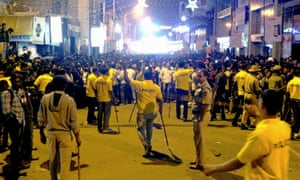 Indian police try to manage crowds during New Year's Eve celebrations in Bangalore.