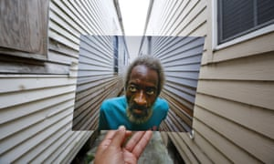Joshua Creek looks at the height that the floodwaters from Hurricane Katrina reached at his house