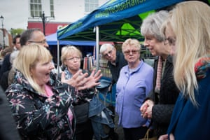 Kathy Mohan confronts Theresa May in Abingdon market in Oxfordshire on Monday, telling the Conservative leader of her struggle to cope after having her disability benefits cut