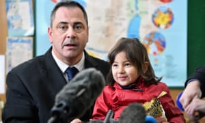 Rob Lawrie with the four-year-old Afghan girl he rescued from Calais