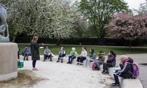 Marie Kaas-Larsen and pupils in a park in Copenhagen.