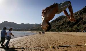 Boy doing backflip, Las Teresitas beach, in Santa Cruz de Tenerife