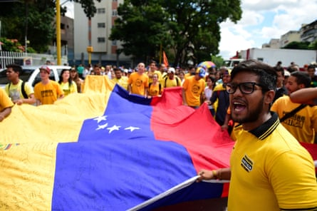 Students demonstrate against the Nicolás Maduro government on the streets of Caracas.