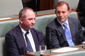 Tony Abbott sits with Barnaby Joyce during a division in question time.