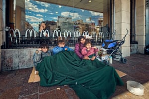 Silvia begging with three children