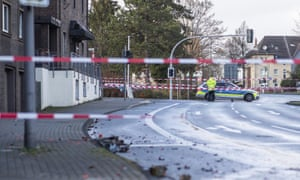 A police officer at the scene of a road traffic incident in Bottrop, Germany
