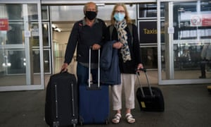 Alan Pechey, 73, and Lisa Pechey, 66, who live in Cambridge, arrive at Gatwick airport on Monday.
